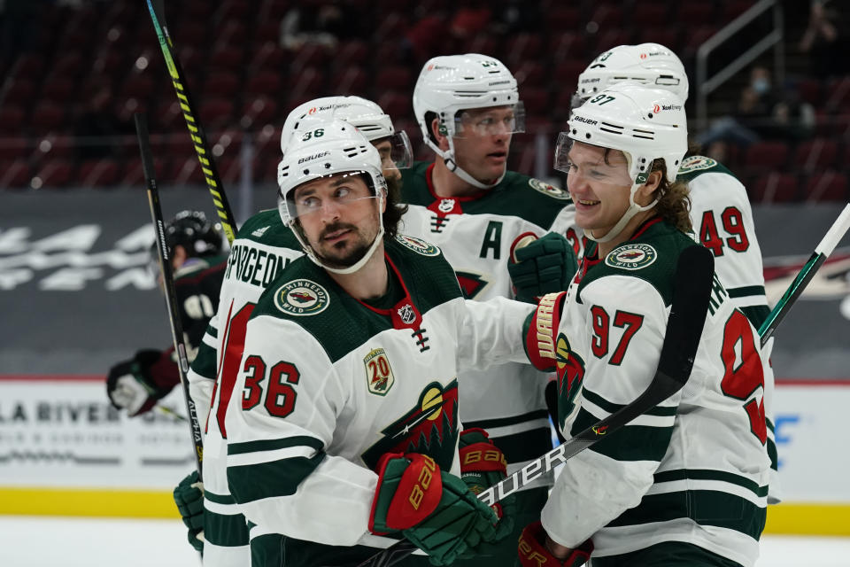 Minnesota Wild Mats Zuccarello (36) celebrates with teammates Kirill Kaprizov (97), Victor Rask (49), Matt Dumba (24) and Jared Spurgeon (46) after scoring a goal against the Arizona Coyotes in the first period during an NHL hockey game, Friday, March 5, 2021, in Glendale, Ariz. (AP Photo/Rick Scuteri)