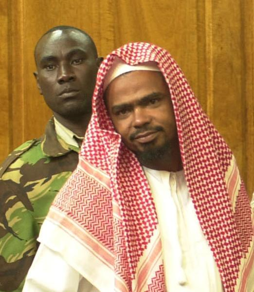 FILE - In this photo of March 15 2000, controversial Muslim cleric Aboud Rogo is seen in in Nairobi High Court, Kenya, during his hearing on terrorism charges. Rogo has been shot dead at a beach in Mombasa according to local sources Monday Aug. 27 2012. Rogo was among three Kenyans whose assets were frozen by the US government over alleged links to terrorism. But the three Aboud Rogo, Abubaker Shariff Ahmed and Omar Awadh Omar denied the charges and challenged the US government to table evidence against them. The cleric was shot inside his car in front of his wife and children. Reports indicate that the wife was injured during the shooting and his 5 year old daughter was shot on her right leg.(AP Photo/Khalil Senosi, File)