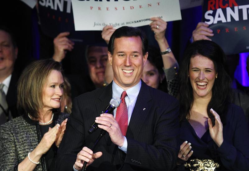 Republican presidential candidate, former Pennsylvania Sen. Rick Santorum smiles at his primary night rally in Grand Rapids, Mich., Tuesday, Feb. 28, 2012. (AP Photo/Paul Sancya)