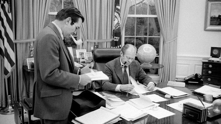 U.S. President Gerald Ford meeting with Donald Rumsfeld at the White House in 1975