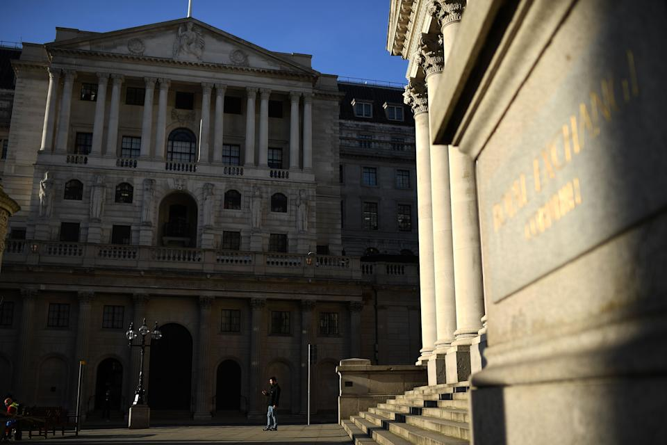 "A man stands in the evening sun outside the Bank of England in central London on March 24, 2020, after Britain's government ordered a lockdown to slow the spread of the novel coronavirus. - Britain was under lockdown March 24, its population joining around 1.7 billion people around the globe ordered to stay indoors to curb the ""accelerating"" spread of the coronavirus. (Photo by DANIEL LEAL-OLIVAS / AFP) (Photo by DANIEL LEAL-OLIVAS/AFP via Getty Images)"