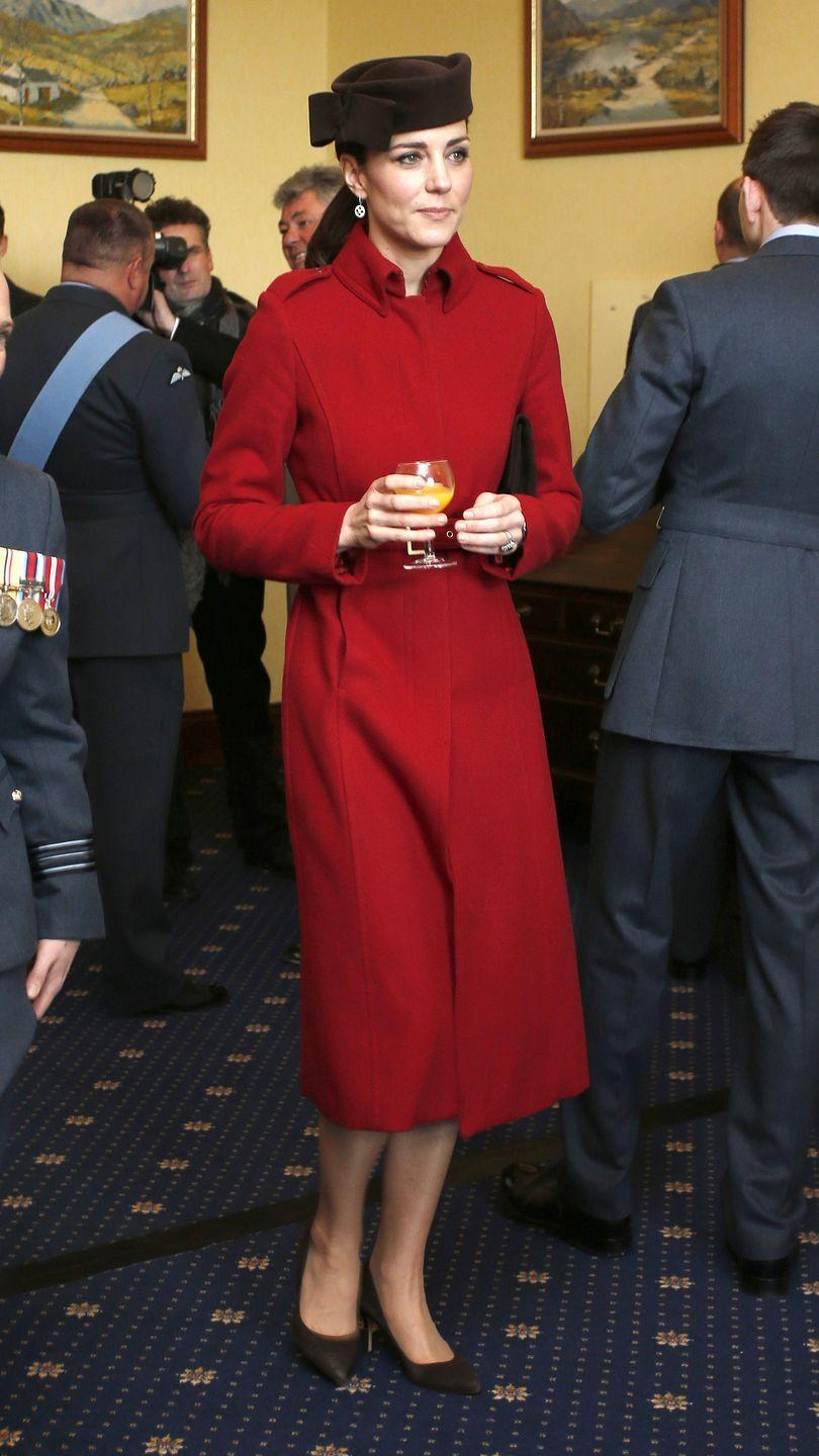 <p>The Duchess looked regal in rouge wearing an L.K.Bennett coat in Anglesey, Wales as she attended a ceremony marking the end of RAF Search and Rescue at the Royal Air Force Valley.</p>
