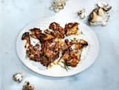 "The frilly edges and large clusters of these mushrooms catch all of the spices and get nice and charred. <a href=""https://www.bonappetit.com/recipe/mushrooms-with-bearnaise-yogurt?mbid=synd_yahoo_rss"" rel=""nofollow noopener"" target=""_blank"" data-ylk=""slk:See recipe."" class=""link rapid-noclick-resp"">See recipe.</a>"