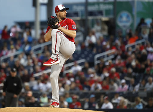 Washington Nationals starting pitcher Max Scherzer winds up in the first inning of a spring training baseball game against the Houston Astros in West Palm Beach, Fla., Saturday, Feb. 22, 2020. (Karen Warren/Houston Chronicle via AP)