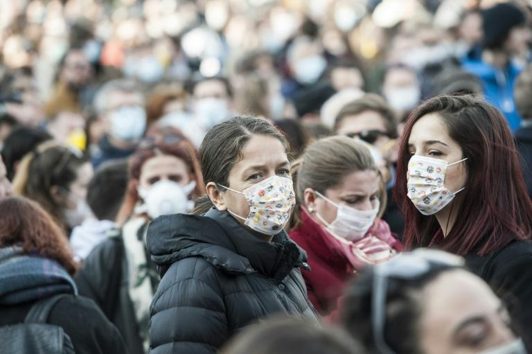 People wear face masks as they take part in a protest against heavy pollution in Kosovo
