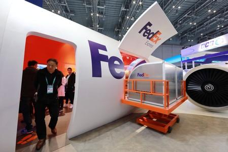 People visit a FedEx Express booth during the China International Import Expo (CIIE) in Shanghai