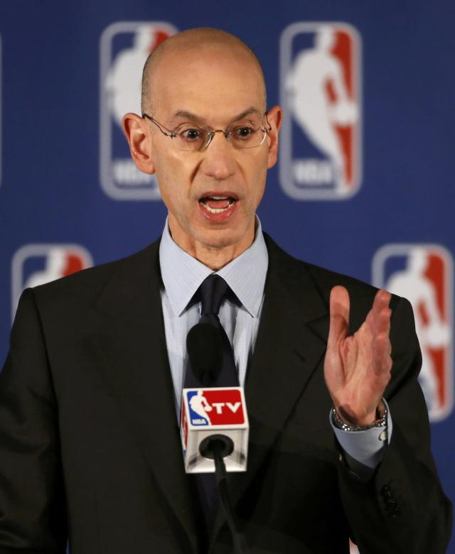 NBA Commissioner Adam Silver speaks at a news conference in New York April 29, 2014. Silver announced that Los Angeles Clippers owner Donald Sterling was banned for life and heavily fined by the NBA on over racist comments he made. REUTERS/Mike Segar (UNITED STATES - Tags: SPORT BASKETBALL)