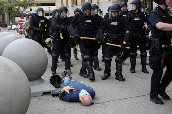 Martin Gugino, a 75-year-old protester, lays on the ground after he was shoved by two Buffalo police officers during a protest Thursday. (Jamie Quinn via Reuters)