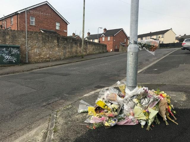 Flowers remain at the spot where Lyra McKee was killed in Creggan, Londonderry