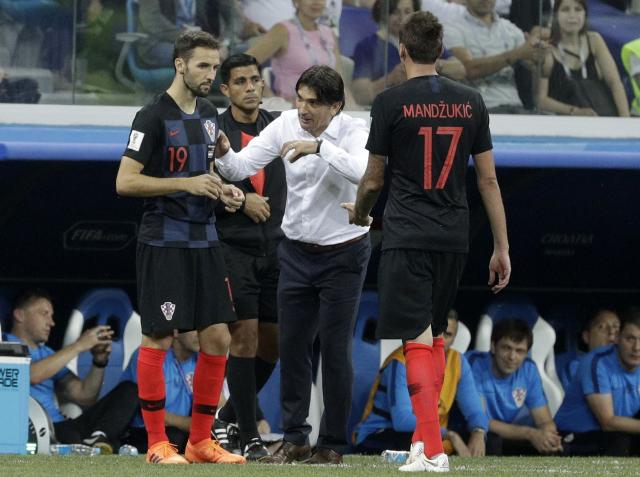 Croatia head coach Zlatko Dalic, center, gives directions to his player Milan Badelj, left, as Mario Mandzukic leaves the pitch during the round of 16 match between Croatia and Denmark at the 2018 soccer World Cup in the Nizhny Novgorod Stadium, in Nizhny Novgorod, Russia, Sunday, July 1, 2018. (AP Photo/Gregorio Borgia)