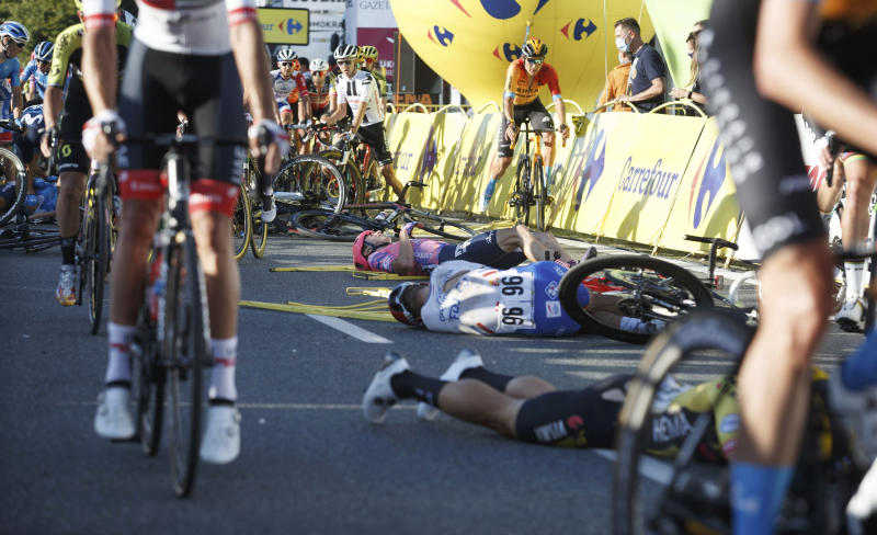 Cyclists are injured in a crash on the final stretch of the opening stage of the Tour de Pologne race in Katowice, Poland, on Wednesday, Aug. 5, 2020. The crash began with a high-speed collision between two Dutchmen sprinting for the win, Fabio Jakobsen and Dylan Groenewegen. Jakobsen was hospitalized in serious condition and put into an induced coma. He was declared the winner of the opening stage and Groenewegen was disqualified after the crash. (AP Photo)