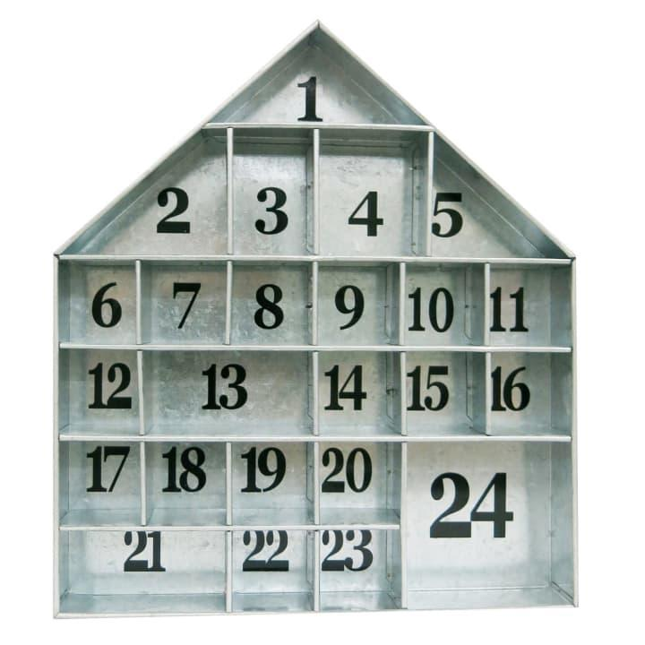 """A galvanized metal advent calendar in the shape of a house couldnt be more perfect for counting down the days until Christmas in a farmhouse-chic home.Open House advent calendar, $25 atTarget<br>See the full slideshow at <a rel=""""nofollow"""" href=""""http://www.sheknows.com/home-and-gardening/slideshow/10009/best-holiday-decor-of-2018/1"""">SheKnows</a>"""