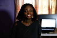 Loveth Metiboba, a researcher and a mother of one is seen during an interview with Reuters in Abuja