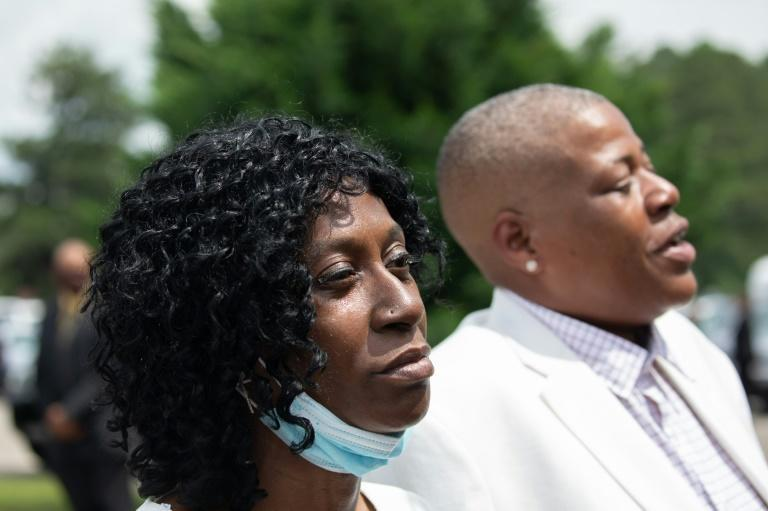 Zsa-Zsa (L) and LaTonya Floyd, sisters of George Floyd, speak to the media at their brother's memorial service in Raeford, North Carolina, on June 6, 2020