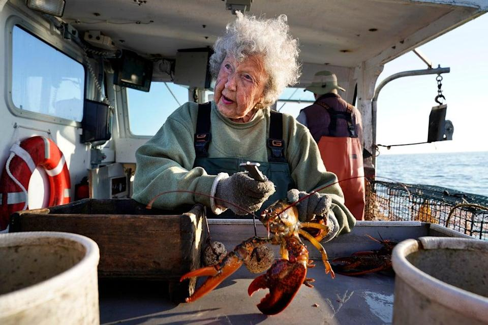 Centenarian Lobsterwoman (Copyright 2021 The Associated Press. All rights reserved.)
