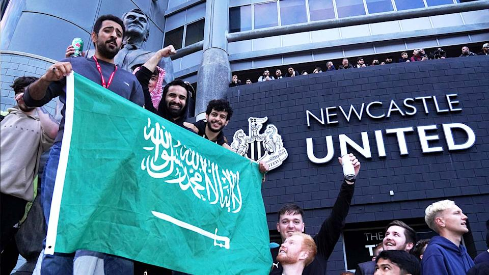 Fans celebrate outside of St James' Park after Newcastle United were taken over by Saudi Arabia's Public Investment Fund (PIF).