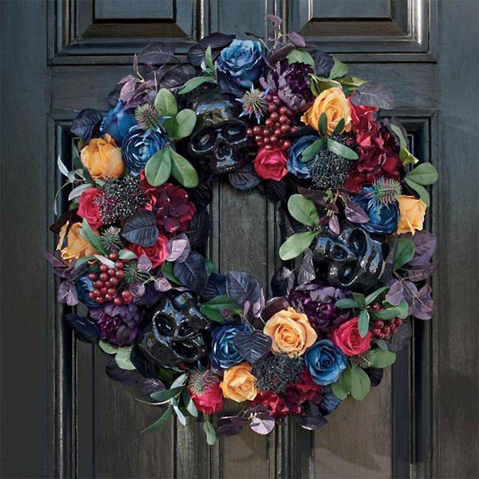 """<p>grandinroad.com</p><p><a href=""""https://go.redirectingat.com?id=74968X1596630&url=https%3A%2F%2Fwww.grandinroad.com%2Fenchanted-mansion-wreath%2Fhalloween-haven%2Fnewest-additions%2F1471593&sref=https%3A%2F%2Fwww.bestproducts.com%2Flifestyle%2Fg36981907%2Fgrandin-road-halloween-decorations%2F"""" rel=""""nofollow noopener"""" target=""""_blank"""" data-ylk=""""slk:Shop Now"""" class=""""link rapid-noclick-resp"""">Shop Now</a></p><p>Who says wreaths are just for Christmastime? This one is made of dark faux flowers, berries, greenery, and skulls that will certainly make a statement every time someone knocks on the door.</p><p><strong>More:</strong> <a href=""""https://www.bestproducts.com/home/g28625505/halloween-door-entryway-decorations/"""" rel=""""nofollow noopener"""" target=""""_blank"""" data-ylk=""""slk:Complete Your Entryway With These Creepy Halloween Door Decorations"""" class=""""link rapid-noclick-resp"""">Complete Your Entryway With These Creepy Halloween Door Decorations</a></p>"""