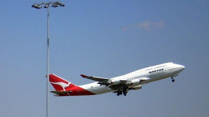 Qantas climbs back to profit