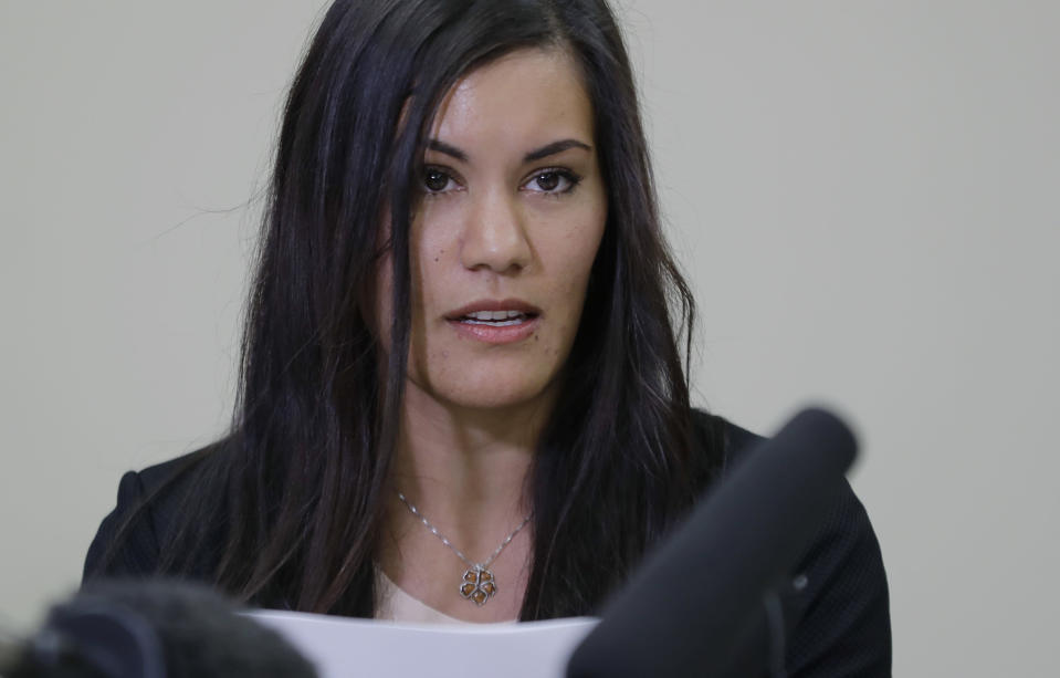 Cora Weberg, a nurse arrested in connection with a possible outbreak of hepatitis C at a hospital in Puyallup, Wash., reads a prepared statement on May 8 in Fircrest, Wash. Weberg said she didn't use drugs and is not a carrier of hepatitis C. (Ted S. Warren/AP)