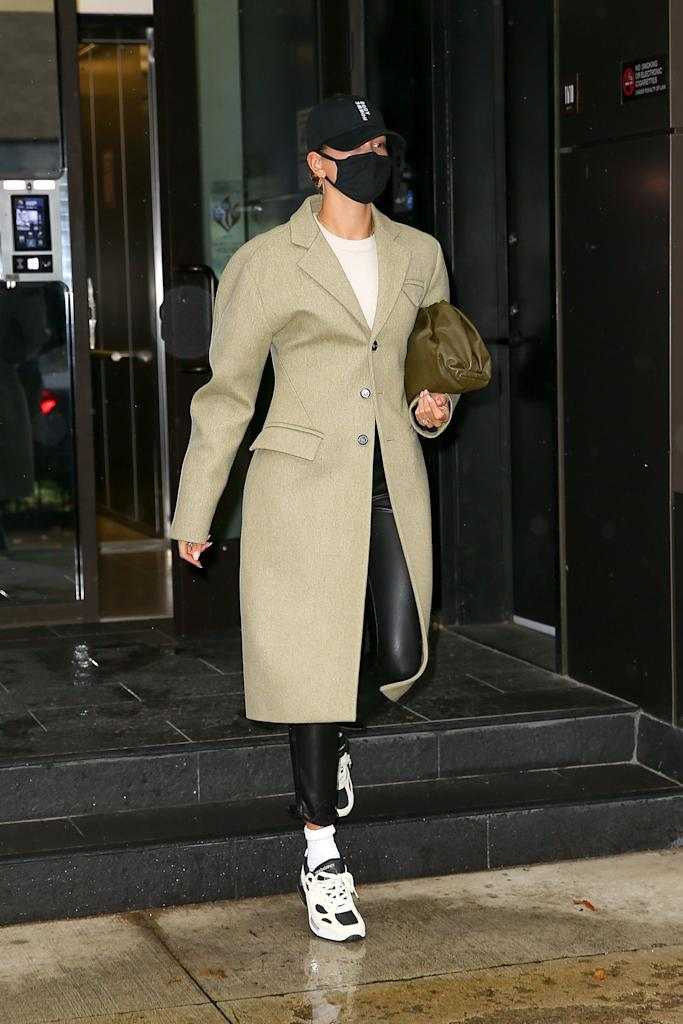 "<p>While out and about in chilly New York, Bieber wrapped up in what is sure to be the coat of 2021 by none other than Bottega Venetta. Taking a queue from fellow Bottega-lover <a href=""https://www.elle.com/uk/fashion/what-to-wear/g29559302/rosie-huntington-whiteley-style/"" rel=""nofollow noopener"" target=""_blank"" data-ylk=""slk:Rosie Huntington-Whitely"" class=""link rapid-noclick-resp"">Rosie Huntington-Whitely</a>, Bieber paired the oat-hued coat (which is available to <a href=""https://go.redirectingat.com?id=127X1599956&url=https%3A%2F%2Fwww.bottegaveneta.com%2Fgb%2Fouterwear_cod16003752mq.html&sref=https%3A%2F%2Fwww.elle.com%2Fuk%2Ffashion%2Fcelebrity-style%2Farticles%2Fg31247%2Fhailey-baldwin-fashion-style-file%2F"" rel=""nofollow noopener"" target=""_blank"" data-ylk=""slk:pre-order here"" class=""link rapid-noclick-resp"">pre-order here</a>), with their pouch bag in a neutral shade, plus a cap and chunky dad trainers.</p><p><a class=""link rapid-noclick-resp"" href=""https://go.redirectingat.com?id=127X1599956&url=https%3A%2F%2Fwww.net-a-porter.com%2Fen-gb%2Fshop%2Fproduct%2Fbottega-veneta%2Fthe-pouch-leather-clutch%2F1151470&sref=https%3A%2F%2Fwww.elle.com%2Fuk%2Ffashion%2Fcelebrity-style%2Farticles%2Fg31247%2Fhailey-baldwin-fashion-style-file%2F"" rel=""nofollow noopener"" target=""_blank"" data-ylk=""slk:SHOP HAILEY'S BAG NOW"">SHOP HAILEY'S BAG NOW</a></p>"