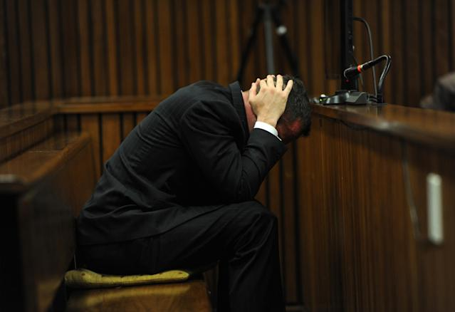 BY COURT ORDER, THESE IMAGES ARE FREE TO USE. PRETORIA, SOUTH AFRICA - APRIL 16: (SOUTH AFRICA OUT):Oscar Pistorius listens to evidence in the Pretoria High Court on April 16, 2014, in Pretoria, South Africa. Oscar Pistorius stands accused of the murder of his girlfriend, Reeva Steenkamp, on February 14, 2013. This is Pistorius' official trial, the result of which will determine the paralympian athlete's fate. (Photo by Werner Beukes/SAPA/Gallo Images/Getty Images)