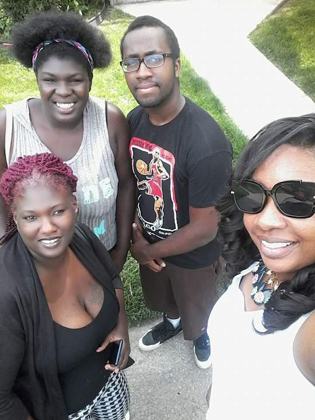 Gooden Brown with her strong support system: (from left) her mother, her boyfriend, and Hearn. (Photo: Quinniya Hearn)