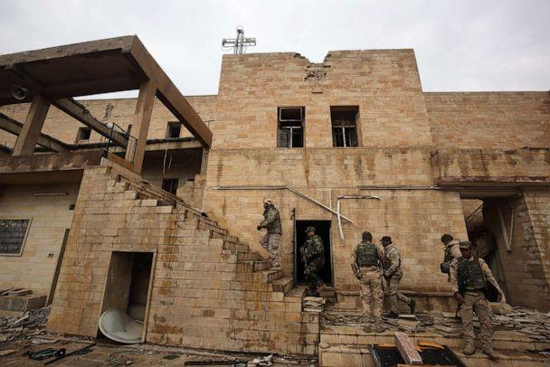 PHOTO: Iraqi soldiers inspect the debris on January 22, 2017 at St. George's Monastery (Mar Gurguis), a historical Chaldean Catholic church on the northern outskirt of Mosul, which was destroyed by Islamic State (IS) group in 2015. (Ahmad Al-rubaye/AFP/Getty Images)