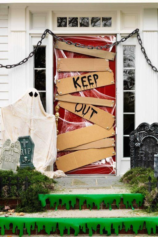 """<p>An unwelcoming entryway is perfect for Halloween. To get the look, stretch cobwebs to somewhat cover the door and secure them with masking tape. Cut cardboard to resemble various-size wood slats. Paint a """"Keep Out"""" sign on two of the slats and glue bolts to each piece of cardboard. Tape the slats to the door and you're done.</p><p><strong>RELATED:</strong><a href=""""https://www.goodhousekeeping.com/holidays/halloween-ideas/g1566/easy-halloween-craft-ideas/"""" rel=""""nofollow noopener"""" target=""""_blank"""" data-ylk=""""slk:Easy Halloween Crafts for Adults Who Love All Things Spooky and Spidery"""" class=""""link rapid-noclick-resp""""> Easy Halloween Crafts for Adults Who Love All Things Spooky and Spidery</a></p>"""