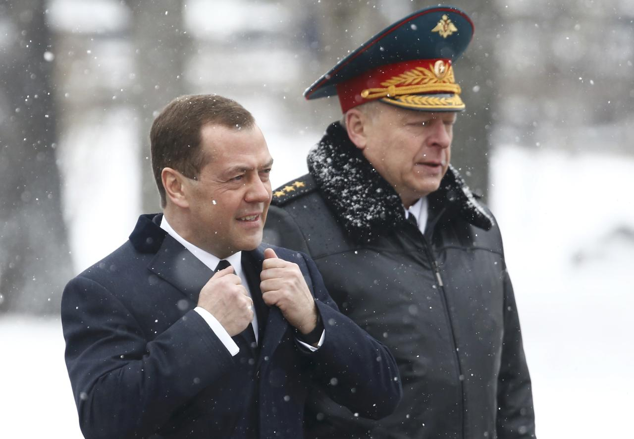 Russian Prime Minister Dmitry Medvedev arrives for a wreath laying ceremony to mark the Defender of the Fatherland Day at the Tomb of the Unknown Soldier by the Kremlin wall in central Moscow, Russia February 23, 2017. REUTERS/Sergei Karpukhin