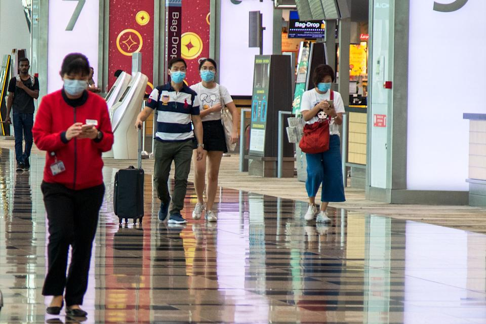People seen wearing face masks at Changi Airport's Terminal 3 on 6 February 2020. (PHOTO: Dhany Osman / Yahoo News Singapore)