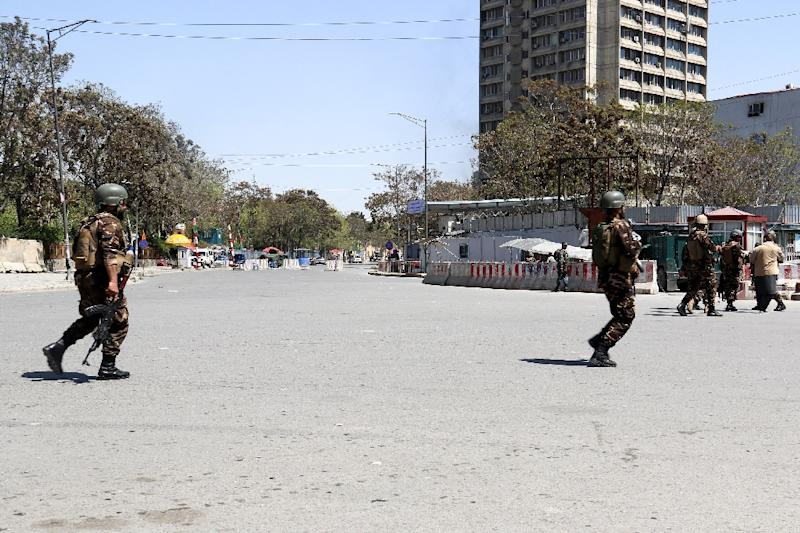 IS claimed responsibility for an attack on a government ministry in Kabul that killed at least seven civilians and three Afghan troops (AFP Photo/STR)