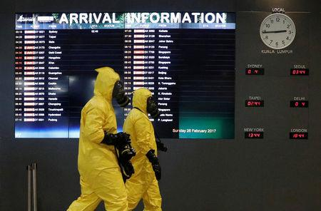 A Hazmat team conducts checks at KLIA2 airport terminal in Sepang, Malaysia February 26, 2017. REUTERS/Edgar Su     TPX IMAGES OF THE DAY