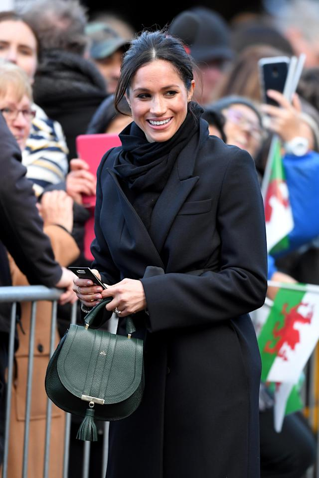 Meghan Markle made sure her green purse popped during a visit to Wales in January. (Photo: Getty Images)