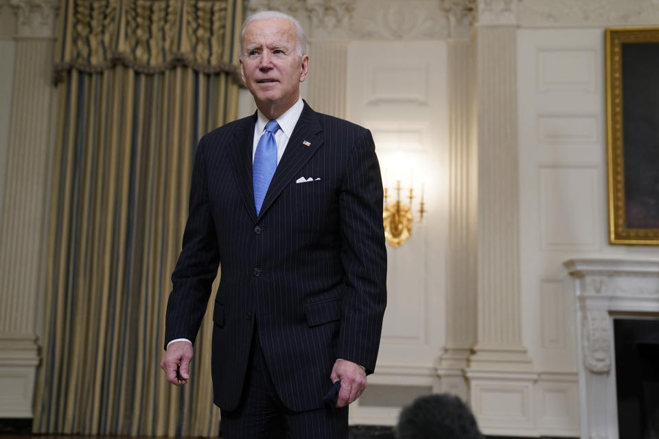 President Joe Biden leaves after speaking about efforts to combat COVID-19, in the State Dining Room of the White House, Tuesday, March 2, 2021, in Washington. (AP Photo/Evan Vucci)