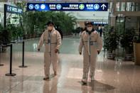 Health workers were waiting to meet the WHO team as they arrived in Wuhan on Thursday ahead of their probe into the origins of the pandemic