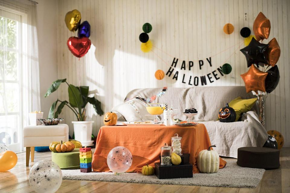 """<p>Nothing will get you more in the Halloween spirit than decking out your house in all things black, orange, and yellow. Throw in a couple of decorative pumpkins and you're all set.</p><p><a class=""""link rapid-noclick-resp"""" href=""""https://www.delish.com/holiday-recipes/halloween/g28699368/halloween-party-decoration-ideas/"""" rel=""""nofollow noopener"""" target=""""_blank"""" data-ylk=""""slk:SHOP HALLOWEEN DECORATIONS"""">SHOP HALLOWEEN DECORATIONS</a></p>"""