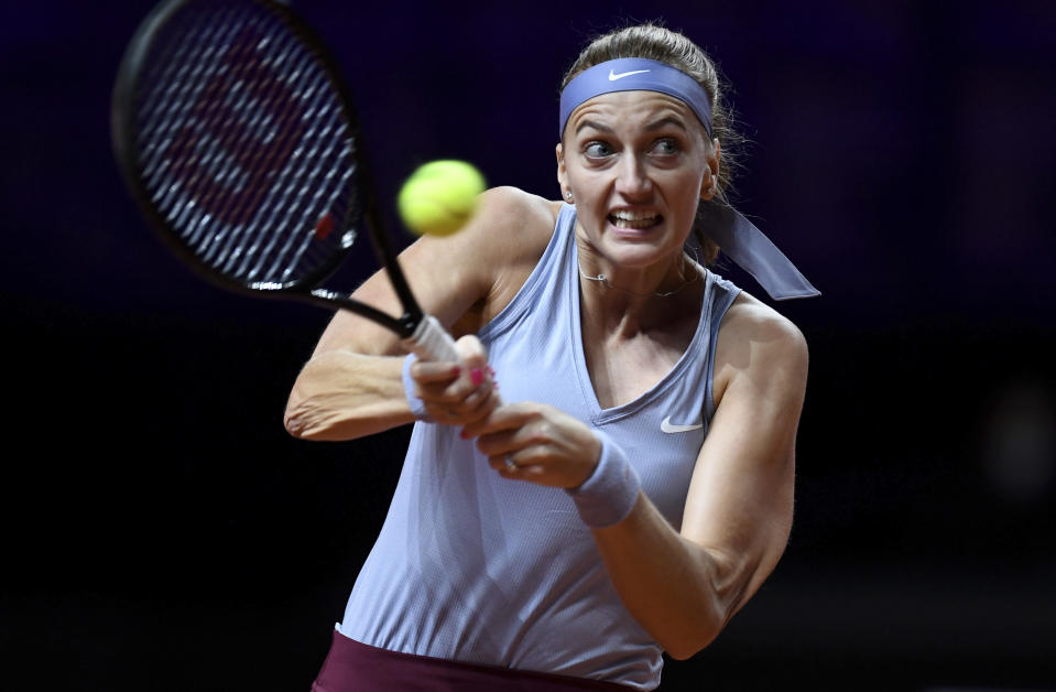 Petra Kvitova of the Czech Republic returns the ball to Jennifer Brady of the United States during their match at the WTA tennis tournament in Stuttgart, Germany, Tuesday, April 20, 2021. (Thomas Kienzle/Pool via AP)