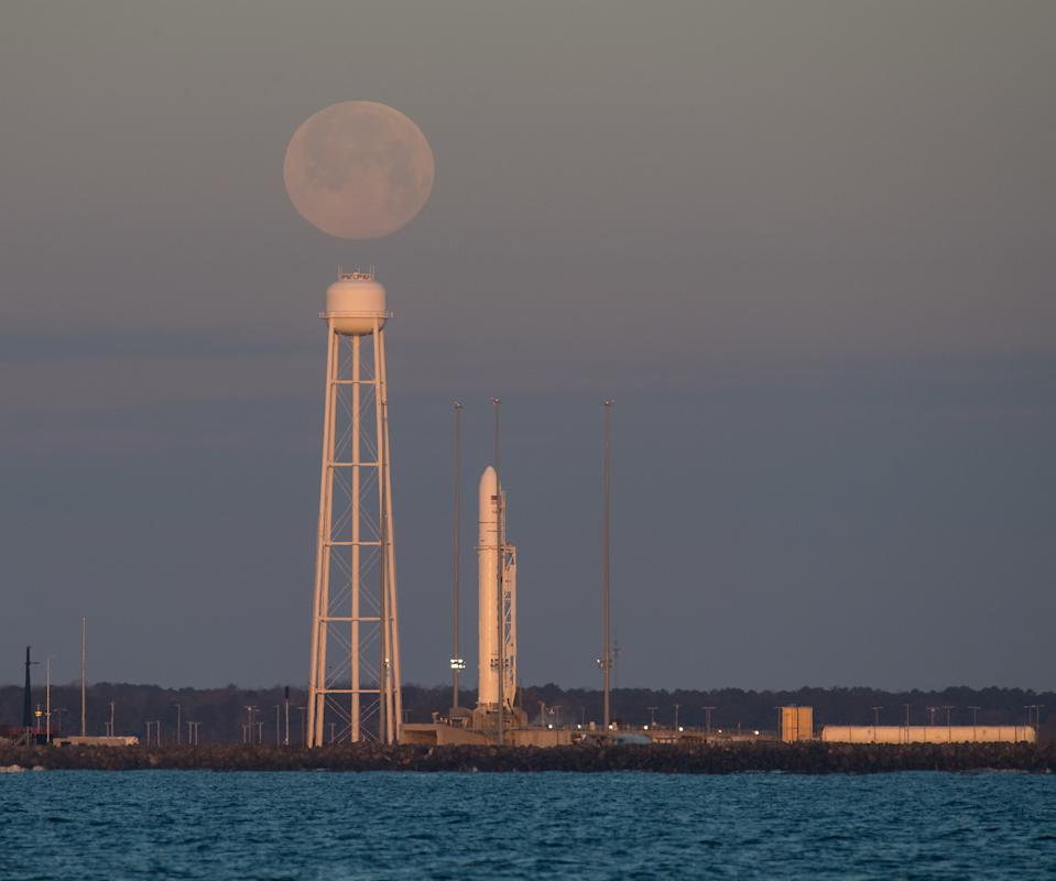 The full moon appears to hover over Pad-0A of NASA's Wallops Flight Facility at dawn on Feb. 9, 2020 where a Northrop Grumman Antares rocket and Cygnus cargo ship stood ready for a launch attempt to the International Space Station.