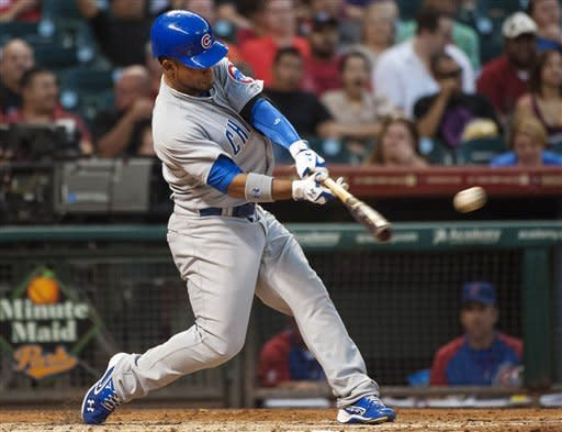 Chicago Cubs' Dave Sappelt hits an RBI double during the second inning of a baseball game against the Houston Astros, Monday, Sept. 10, 2012, in Houston. (AP Photo/Dave Einsel)