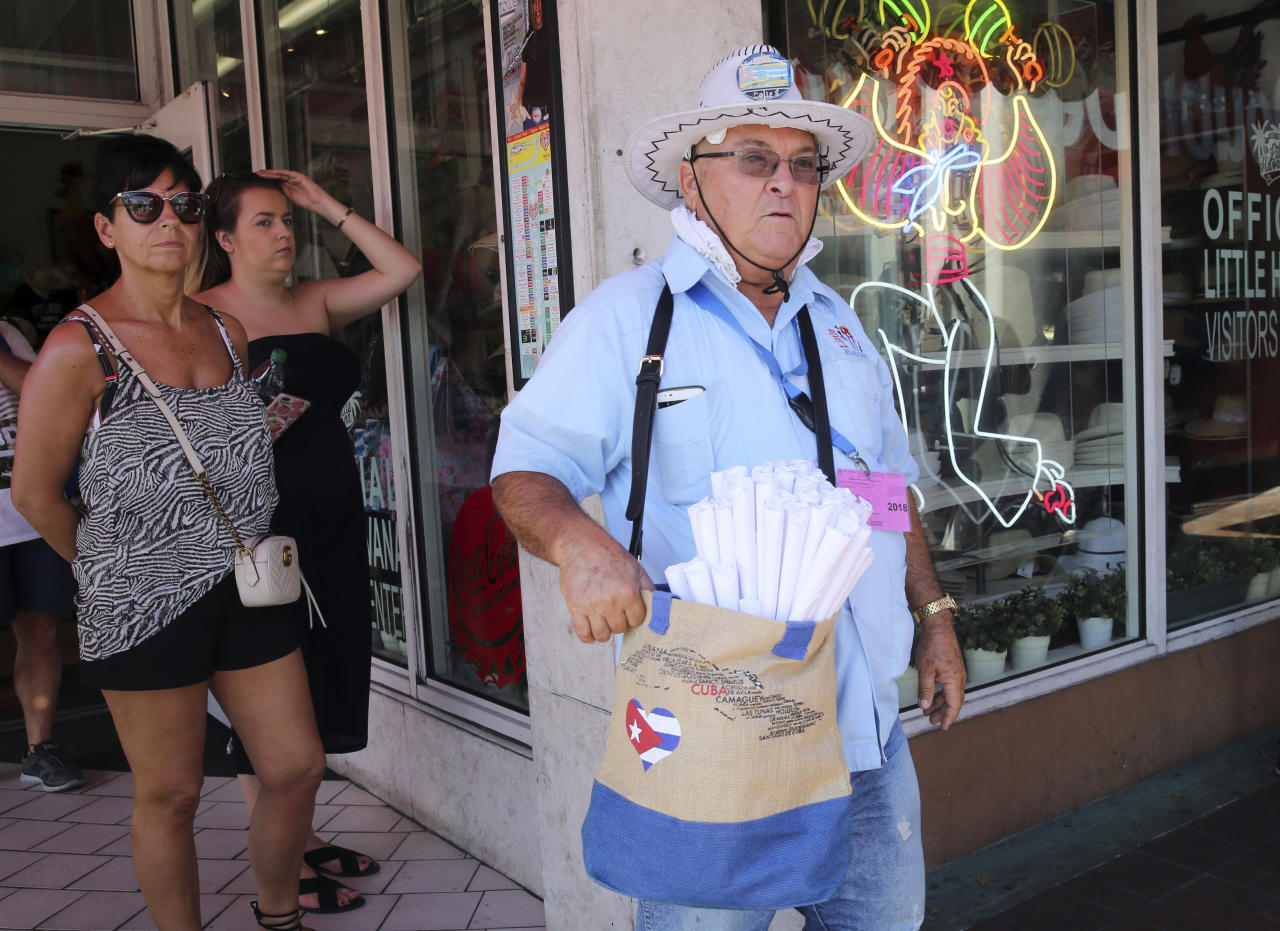 Francisco Cazanas sells roasted peanuts to tourists in the Little Havana neighborhood of Miami, Thursday, April 19, 2018. Cazanas does not believe real change will come to Cuba until its citizens are able to democratically elect their government. The Cuban government selected 57-year-old First Vice President Miguel Mario Diaz-Canel Bermudez as the sole candidate to succeed President Raul Castro in a transition aimed at ensuring the country's single-party system outlasts the aging revolutionaries who created it. (AP Photo/Marta Lavandier)