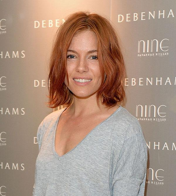 <br>...She makes a serious case for dying your hair a fiery hue - and not to mention her perfectly styled, tousled bob!