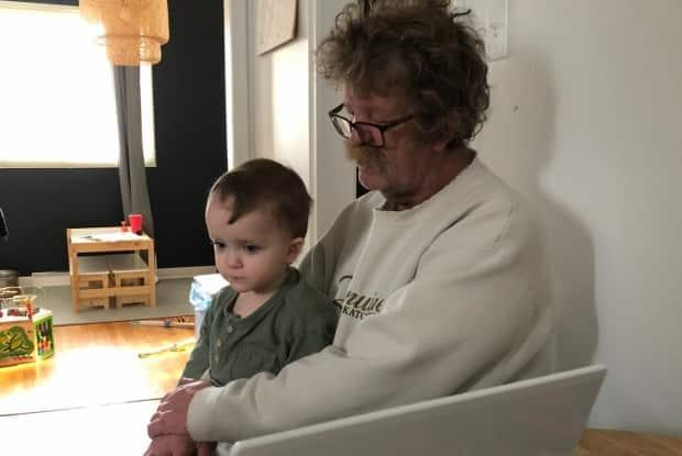 Richard Baron holds one of his grandchildren. The 64-year-old Regina resident was just diagnosed with cancer that has spread to his brain.  (Submitted by Ashleigh Woytuik - image credit)