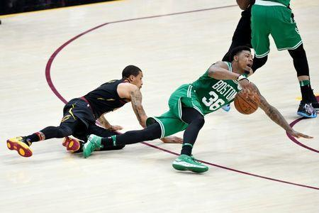 May 21, 2018; Cleveland, OH, USA; Boston Celtics guard Marcus Smart (36) and Cleveland Cavaliers guard George Hill (3) scramble for the ball in the second quarter in game four of the Eastern conference finals of the 2018 NBA Playoffs at Quicken Loans Arena. Mandatory Credit: David Richard-USA TODAY Sports
