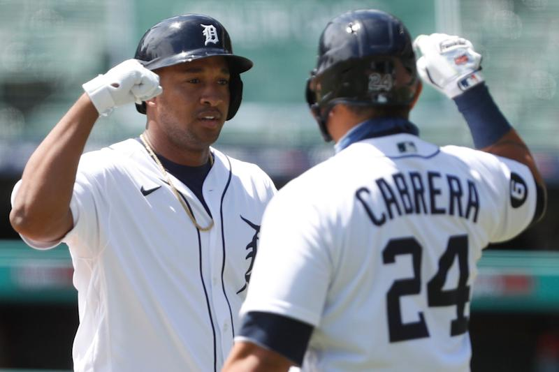 Tigers second baseman Jonathan Schoop celebrates with designated hitter Miguel Cabrera after hitting a solo home run during the first inning on Wednesday, Aug. 12, 2020, at Comerica Park.