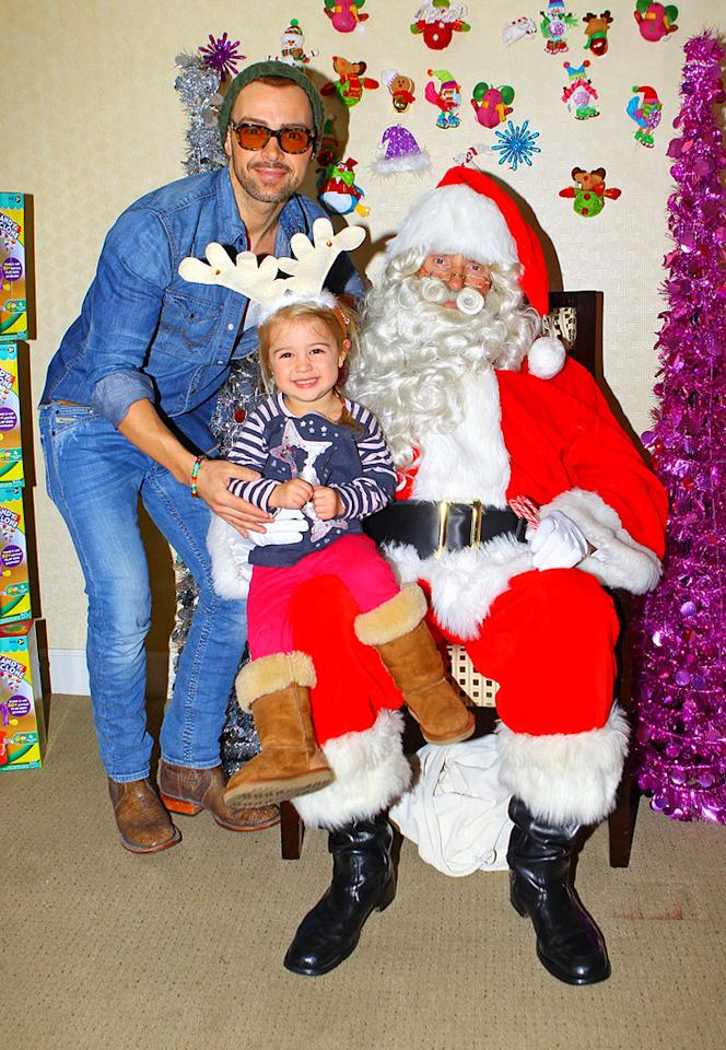 **EXCLUSIVE** Joey Lawrence and his daughter Charleston get into the holiday spirit at the Jayneoni Holiday House in Los Angeles