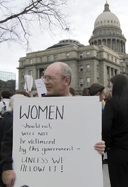 Protester Vernon Ray demonstrates against legislation requiring women seeking an abortion to undergo ultrasound outside of the Idaho Capitol on Wednesday, March 21, 2012 in Boise. Protesters gathered as an anti-abortion group held a live ultrasound exhibition inside the building. (AP Photo/Jessie L. Bonner)