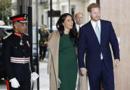 """FILE - In this Tuesday, Oct. 15, 2019 file photo, Britain's Prince Harry and Meghan, the Duke and Duchess of Sussex arrive to attend the WellChild Awards Ceremony in London. In a stunning declaration, Britain's Prince Harry and his wife, Meghan, said they are planning """"to step back"""" as senior members of the royal family and """"work to become financially independent."""" A statement issued by the couple Wednesday, Jan. 8, 2020 also said they intend to """"balance"""" their time between the U.K. and North America(AP Photo/Kirsty Wigglesworth, file)"""