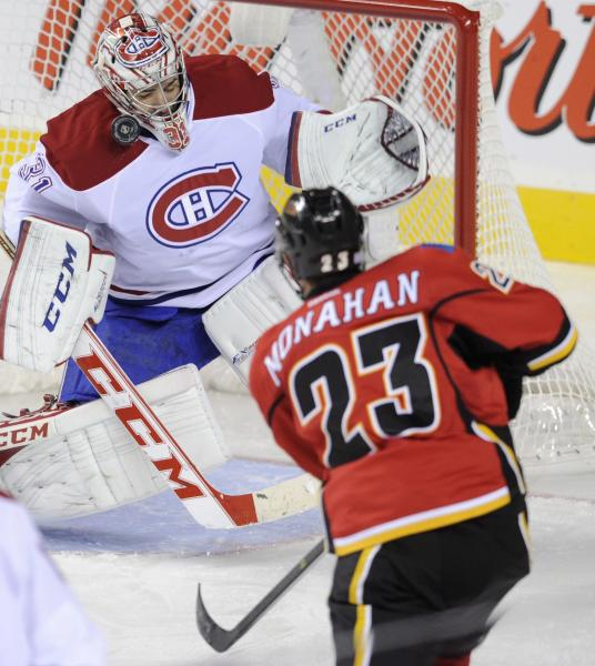 Montreal Canadiens goalie Carey Price, left, makes a save against Calgary Flames' Sean Monahan during the third period of an NHL hockey game Wednesday, Oct. 9, 2013, in Calgary, Alberta. (AP Photo/The Canadian Press, Larry MacDougal)