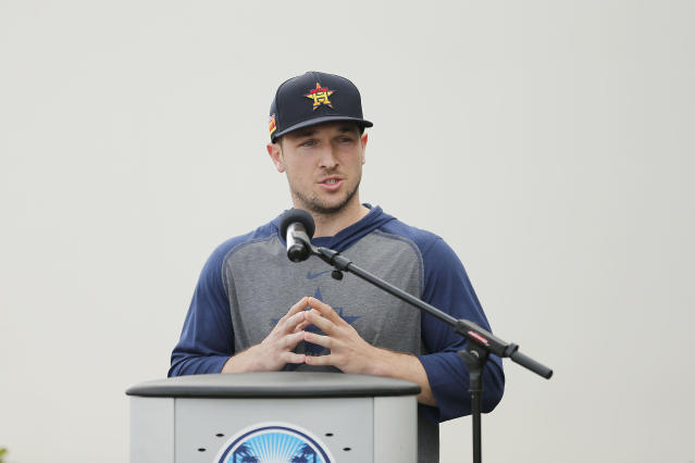 Star Houston Astros third baseman Alex Bregman read a seemingly practiced statement of apology over the 2017 team's sign-stealing scandal at a news conference Thursday. (Photo by Michael Reaves/Getty Images)