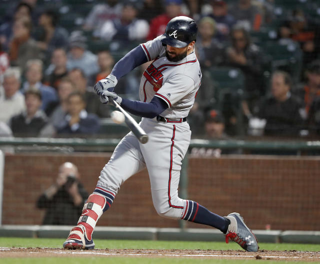 Atlanta Braves' Nick Markakis (22) hits a single against the San Francisco Giants during the second inning of a baseball game in San Francisco, Tuesday, Sept. 11, 2018. (AP Photo/Tony Avelar)
